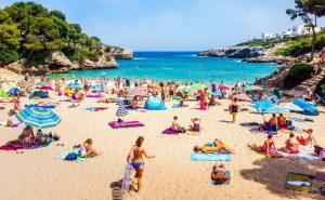 Tourists relaxing on Cala Esmeralda Beach, Santanyi, Mallorca